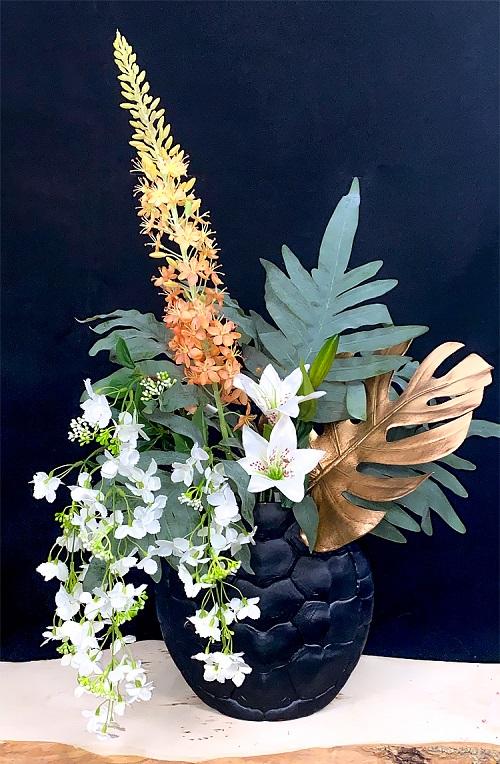 Zijden bloemen zwarte vaas